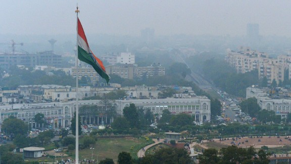 In this photograph taken on February 24, 2015, shows the Indian tri-colour as it flies over Connaught Place in New Delhi, ahead of World Environment Day which falls on June 5.   The Indian government is under intense pressure to act after the World Health Organization last year declared New Delhi the world