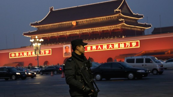 BEIJING, CHINA - NOVEMBER 08:  An anti-terror police officer patrols with the gun at Tiananmen Square on November 8, 2013 in Beijing, China. The Communist Party of China (CPC) will convene the Third Plenary Session of the 18th CPC Central Committee from November 9 to 12 to discuss comprehensively deepening reforms.  (Photo by Feng Li/Getty Images)
