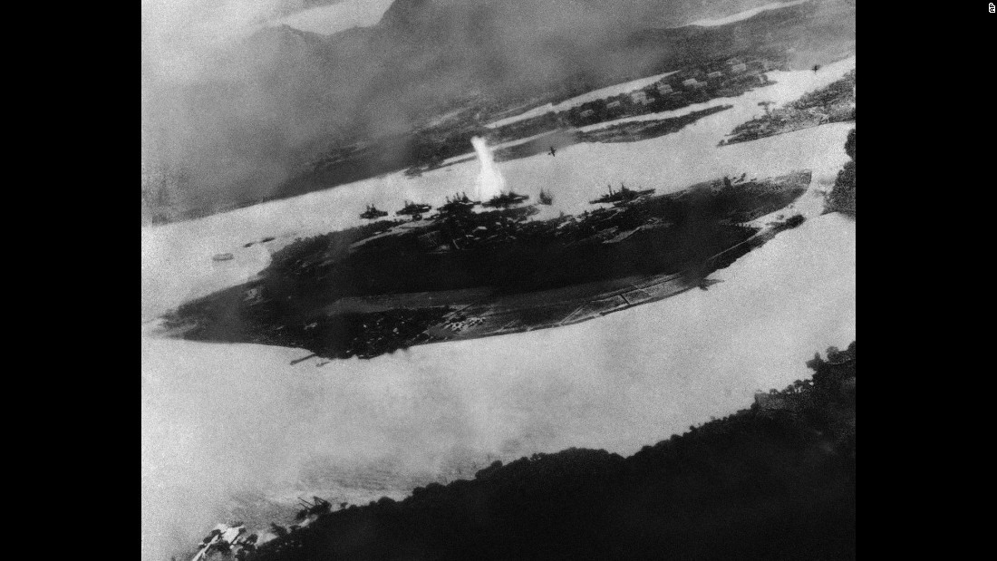 This is believed to be an image of the first bomb dropped during the raid on Pearl Harbor; it shows a Japanese plane pulling out of a dive near the explosion.