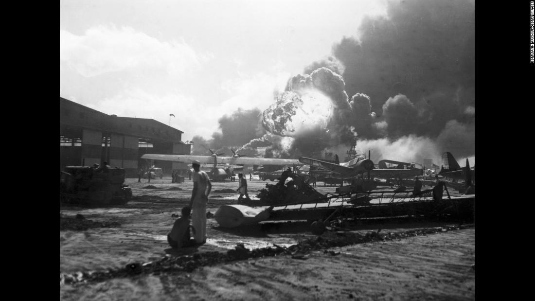 Airmen at Hickam Field watch as bombs explode. The Hickam Field airbase was heavily targeted during the attack, and Japanese bombers sought to prevent counter-attacks from US forces by disabling American planes on the ground.
