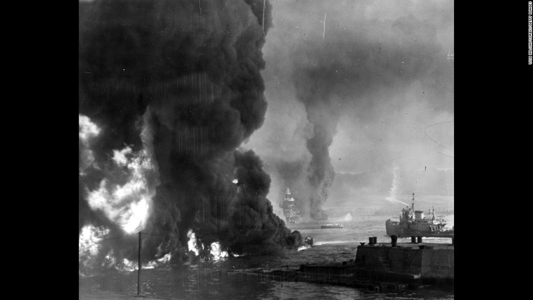 Oil burns on the ocean's surface near the Naval Air Station shortly after the attack on Pearl Harbor.