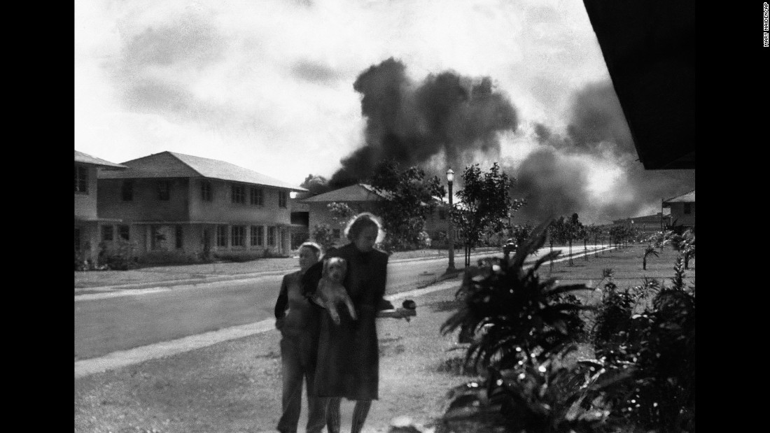Wives of US military officers return to their residences after an explosion at Pearl Harbor.