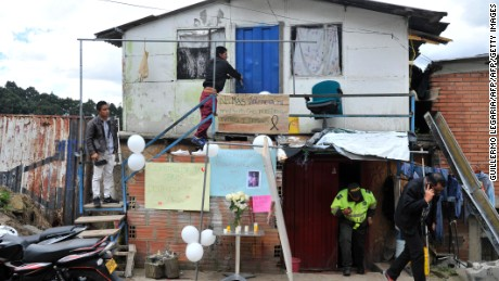 A policeman leaves the house of a seven-year-old girl who was raped, tortured and murdered in Bogota, Colombia, on December 6, 2016. A seven-year-old girl was raped, tortured and murdered in Bogota this weekend, allegedly by a 38-year-old man who kidnapped the girl in her low-income neighborhood on the east of the city and took her to a luxury apartment belonging to his family, the police said. The girl's body was found on the scene, showing signs of torture and sexual abuse. / AFP / Guillermo LEGARIA        (Photo credit should read GUILLERMO LEGARIA/AFP/Getty Images)