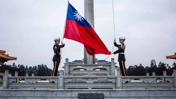 TAIPEI, TAIWAN - JANUARY 14:  Honor guards raise the Taiwan flag in the Chiang Kai-shek Memorial Hall square ahead of the Taiwanese presidential election on January 14, 2016 in Taipei, Taiwan. Voters in Taiwan are set to elect Tsai Ing-wen, the chairwoman of the opposition Democratic Progressive Party, to become the island
