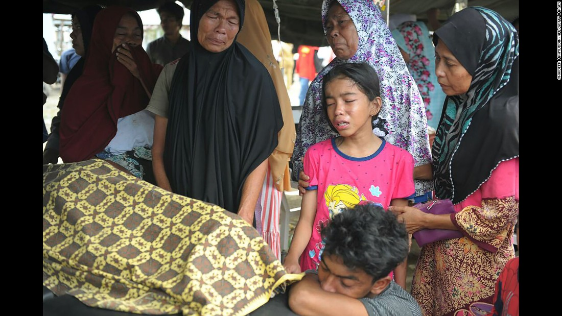 A family reacts to the death of a relative who was killed in the earthquake.