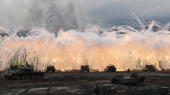 Japan Self-Defense Force tanks and other armored vehicles take part in an exercise at the military