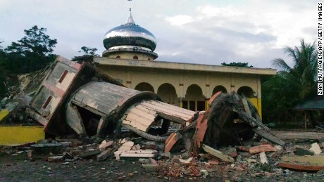 A collapsed mosque minaret is seen after a 6.5-magnitude earthquake struck the town of Pidie, Indonesia's Aceh province in northern Sumatra, on December 7, 2016. One person died and dozens were feared trapped in rubble after a strong earthquake struck off Aceh province on Indonesia's Sumatra island on December 7, officials said.  / AFP / ZIAN MUTTAQIEN        (Photo credit should read ZIAN MUTTAQIEN/AFP/Getty Images)