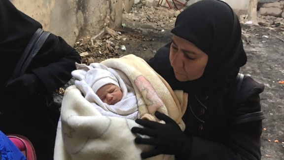 Residents, including this 7-day-old baby, flee eastern Aleppo after the Syrian army's gains.