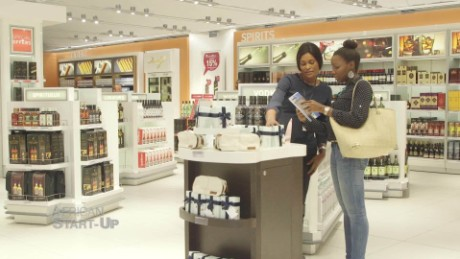 Image result for Young business owner in a busy shop - Nigeria