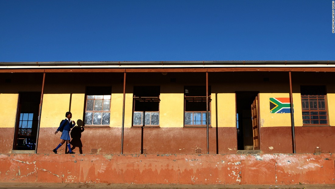 Nearly seven-in-ten South Africans believe education will be better for their children, according to the survey. <br />Pictured here: a student walks to school in the town of Mthatha in the Eastern Cape in June 2013.