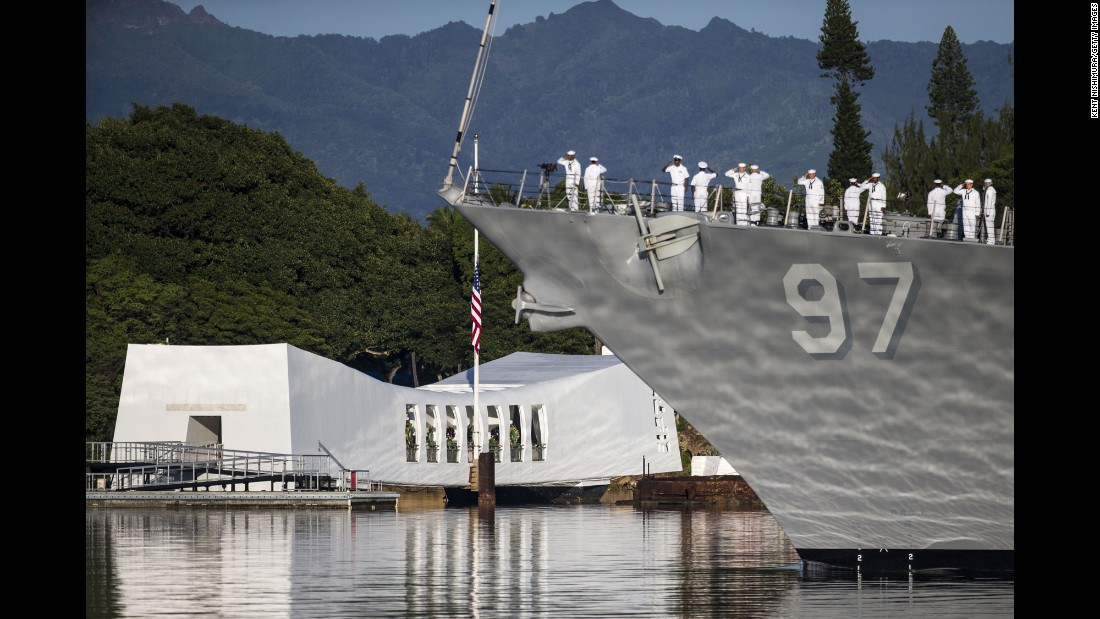 Members of the Navy on the USS Halsey in Honolulu take part in a commemoration ceremony marking the 75th anniversary of the attack on Pearl Harbor on Wednesday, December 7.