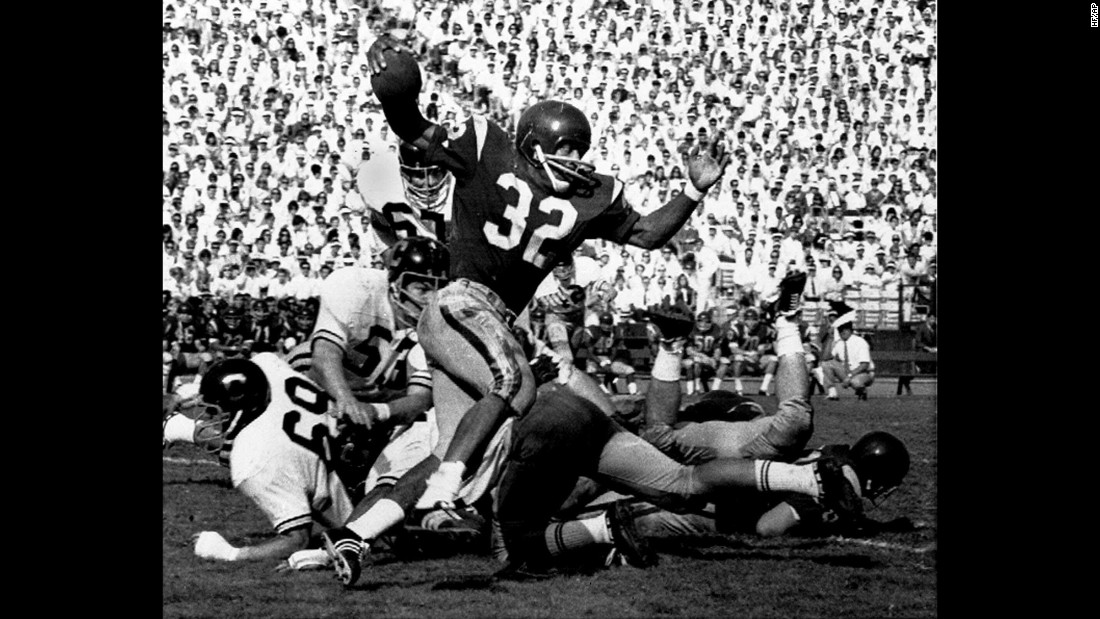O.J. Simpson, playing for the University of Southern California, tries to break a tackle as he picks up 5 yards in Los Angeles Memorial Coliseum on November 9, 1968. That year, Simpson scored 22 touchdowns.