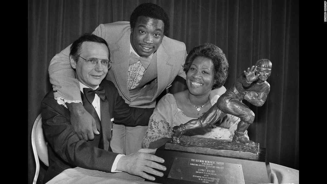 "Heisman Trophy winner George Rogers, center, poses with his mother, Grady Rogers, and South Carolina Gov. Richard Riley, after he was formally presented with the trophy at a dinner in New York on December 12, 1980. In accepting the trophy, Rogers paid tribute to his mother and his coaches. ""I'm happy for the University and for my teammates, too,"" Rogers said."