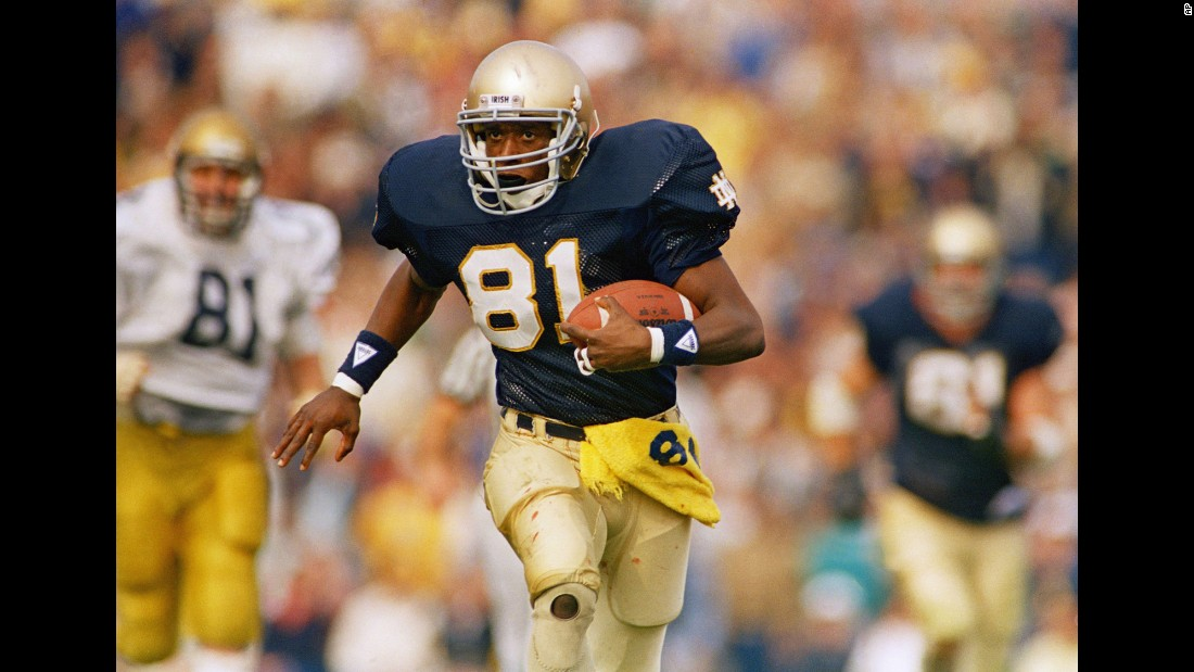 Tim Brown plays in a game at Notre Dame in 1987. Notre Dame and Ohio State are tied with seven Heisman trophy wins, the most any school has won.