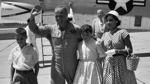 """Glenn's family -- wife  Annie, daughter, Carolyn """"Lyn"""" and son David -- greet him at Floyd Bennett Field in New York after his record-breaking transcontinental flight."""