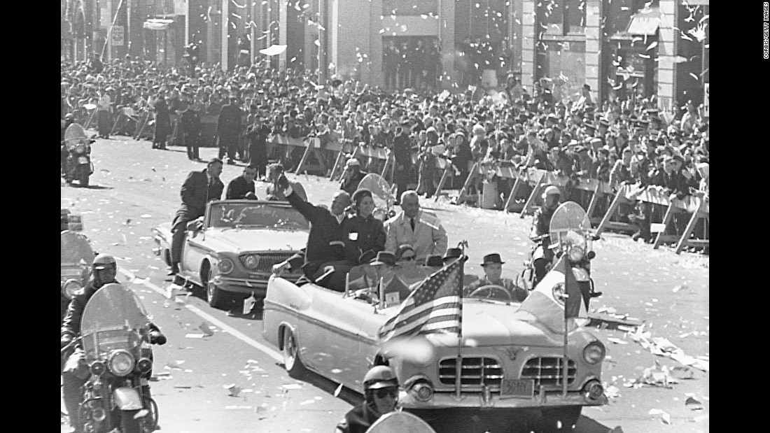 Following his Mercury flight, Glenn and his wife, Annie, join Vice President Lyndon Johnson in the front car of a New York motorcade parade honoring the astronaut. An estimated 4 million people turned out for the March 1, 1962, ticker-tape parade.