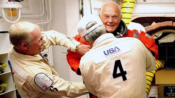 On October 29, 1998, Glenn, then 77, became the oldest person to venture into space. Here, he has his flight suit checked before climbing into the space shuttle Discovery. His second flight into space came 36 years after his legendary Mercury launch.