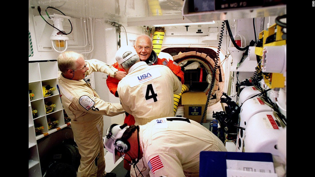 "On October 29, 1998, Glenn, then 77, became the <a href=""http://www.cnn.com/TECH/space/9811/02/shuttle.02/index.html?iref=allsearch"" target=""_blank"">oldest person to venture into space.</a> Here, he has his flight suit checked before climbing into the space shuttle Discovery. His second flight into space came 36 years after his legendary Mercury launch."
