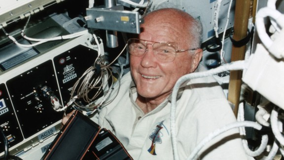 Glenn is seen aboard the shuttle Discovery in 1998. He was a STS-95 payload specialist on the nine-day mission.