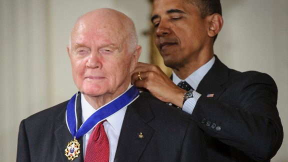 President Barack Obama presents Glenn with the Presidential Medal of Freedom during a May 2012 ceremony at the White House.