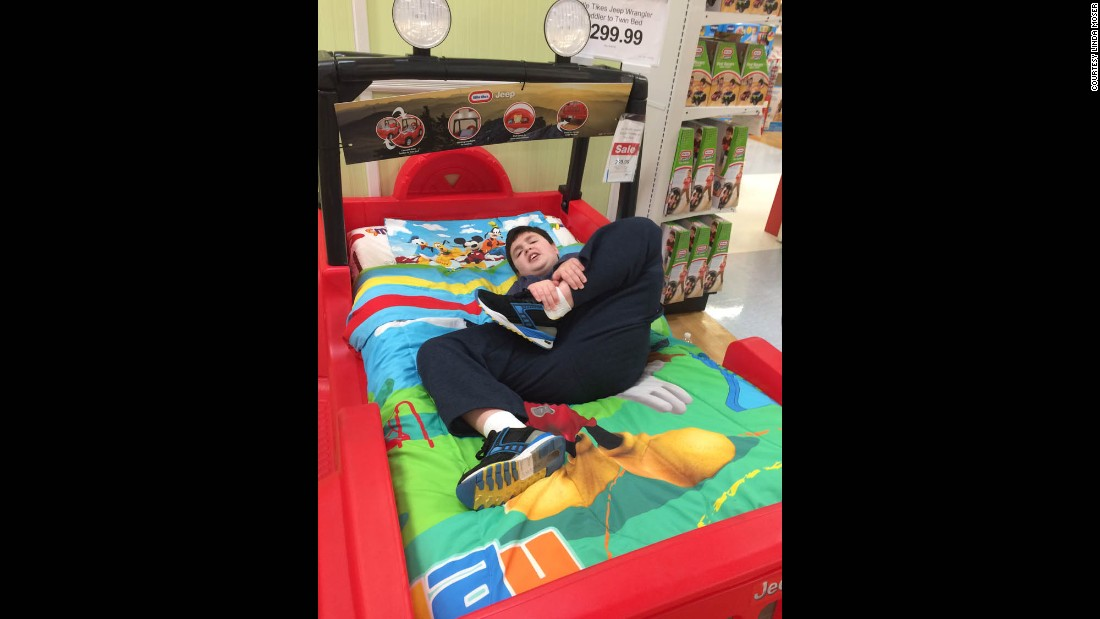 Adam's mom returned to the store later to buy the bed.