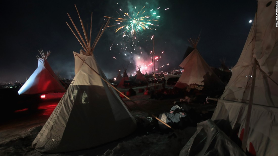 "Fireworks light the sky on Sunday, December 4, at the Oceti Sakowin camp near Cannon Ball, North Dakota after news that the Dakota Access Pipeline may be rerouted. The Army Corps of Engineers has <a href=""http://www.cnn.com/2016/12/04/politics/dakota-access-pipeline/index.html"" target=""_blank"">denied the current route for the Dakota Access Pipeline</a>, a $3.7 billion project that would cross four states and change the landscape of the US crude oil supply."