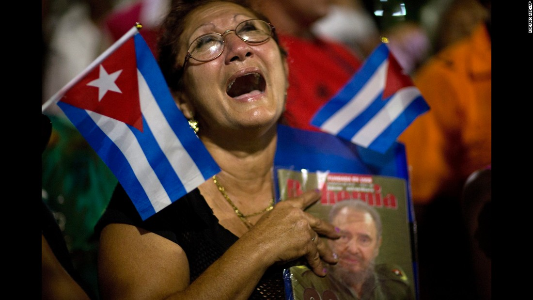 "A woman holding a portrait of longtime Cuban leader Fidel Castro cries moments after his funeral procession passed by in Bayamo, Cuba, on Friday, December 2. Castro <a href=""http://www.cnn.com/2015/07/05/world/gallery/fidel-castro/index.html"" target=""_blank"">died at age 90</a> on November 25. <a href=""http://www.cnn.com/2016/11/28/americas/gallery/cuba-remembers-castro/index.html"" target=""_blank"">Cuba remembers Castro</a>"