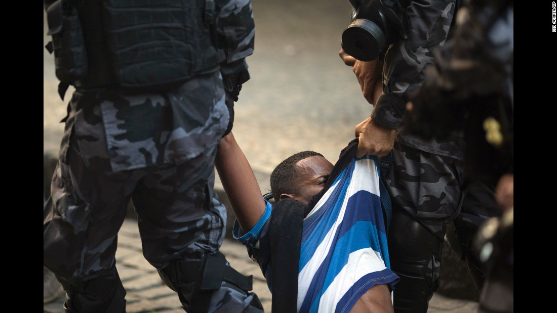 A demonstrator is arrested by police outside the state Legislature during a protest against newly proposed austerity measures in Rio de Janeiro on Tuesday, December 6. Hundreds of public sector workers have been protesting against possible spending cuts in the cash-strapped country.