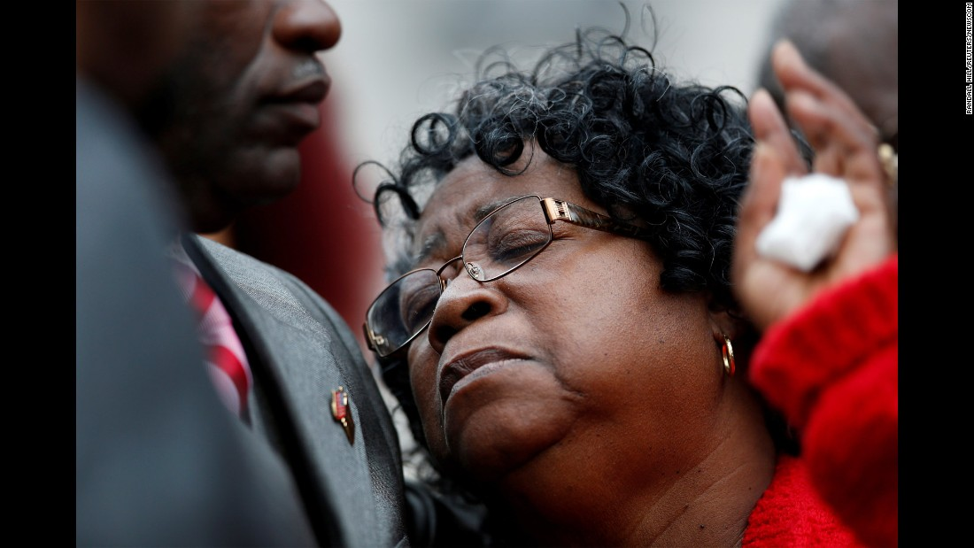 "Walter Scott's mother, Judy Scott, is comforted by her son, Rodney Scott, <a href=""http://www.cnn.com/2016/12/05/us/michael-slager-murder-trial-walter-scott-mistrial/index.html"" target=""_blank"">after a judge declared a mistrial</a> in the murder trial against former police officer Michael Slager outside a courthouse in Charleston, South Carolina, on Monday, December 5. Slager shot and killed <a href=""http://www.cnn.com/2015/04/08/us/south-carolina-who-was-walter-scott/"" target=""_blank"">Walter Scott</a>, 50, after an April 4, 2015, traffic stop. The shooting, which was captured on a bystander's cell phone video, showed Scott running away as Slager fired eight times, striking Scott three times in the back."