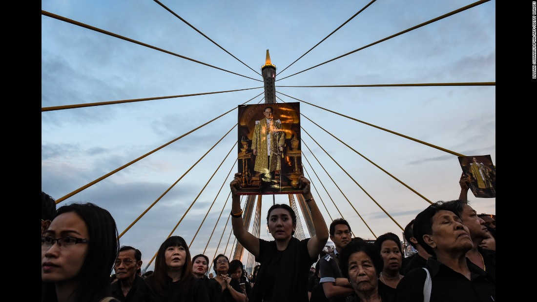 "A woman holds a picture of the late Thai King Bhumibol Adulyadej as people gather to commemorate his birthday on Bhumibol Bridge in Bangkok, Thailand, on Monday, December 5. Bhumibol, a revered figure who helped unify the nation in his 70-year reign, <a href=""http://www.cnn.com/2016/10/13/asia/thai-king-bhumibol-adulyadej-dies/"" target=""_blank"">died on October 13</a> at age 88. <a href=""http://www.cnn.com/2016/10/12/asia/gallery/thai-king-bhumibol-adulyadej/index.html"" target=""_blank"">Thailand's King Bhumibol Adulyadej: A life in pictures</a>"