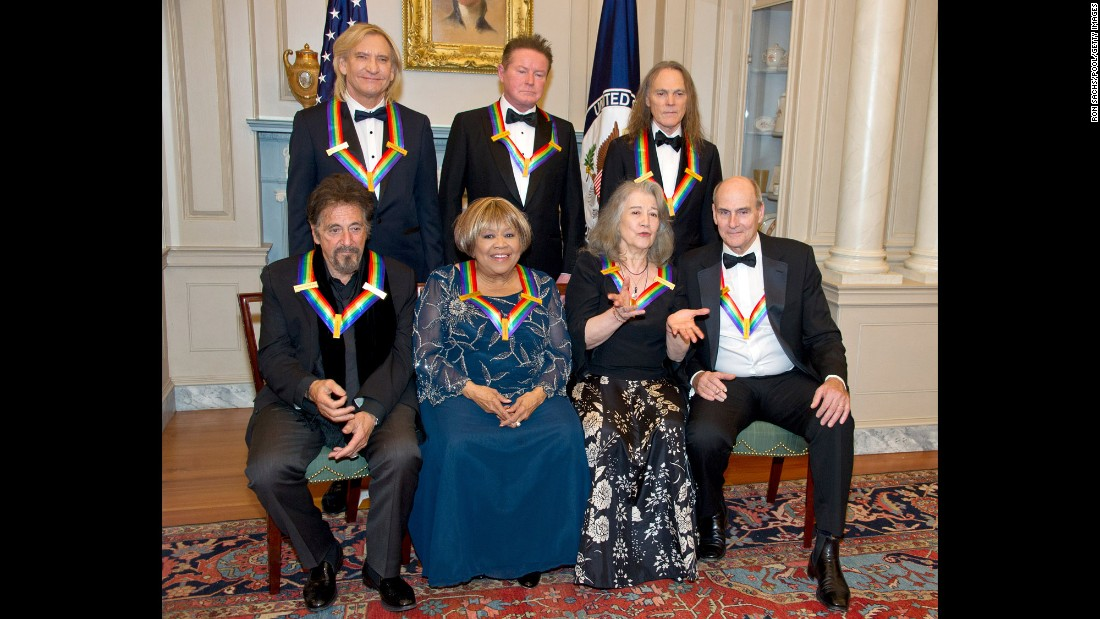 "The recipients of the <a href=""http://www.cnn.com/2016/12/05/entertainment/kennedy-center-honors-al-pacino-james-taylor/"" target=""_blank"">39th Annual Kennedy Center Honors</a> pose for a group photo after a dinner hosted by US Secretary of State John Kerry in Washington on Saturday, December 3. In the back row are the three surviving members of the Eagles: Joe Walsh, left, Don Henley and Timothy B. Schmidt. Seated are actor Al Pacino, left, gospel singer Mavis Staples, pianist Martha Argerich and singer-songwriter James Taylor."