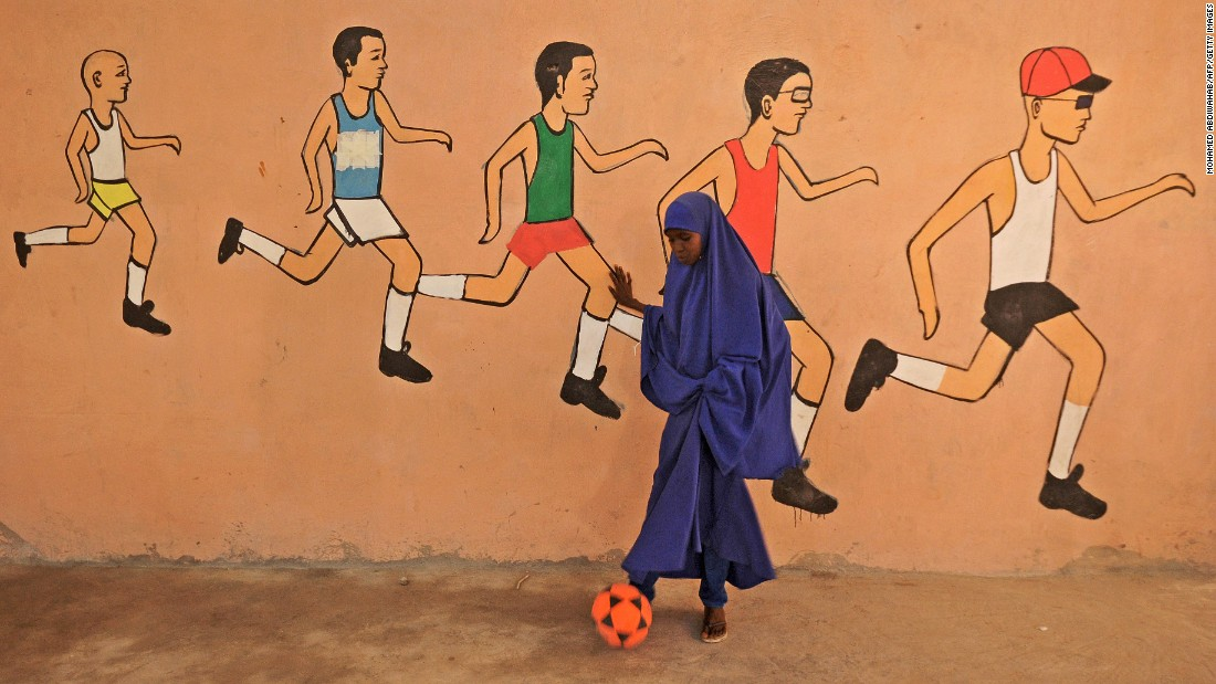 A girl kicks a ball during a sports lesson at a school in Mogadishu, Somalia, on Tuesday, December 6.