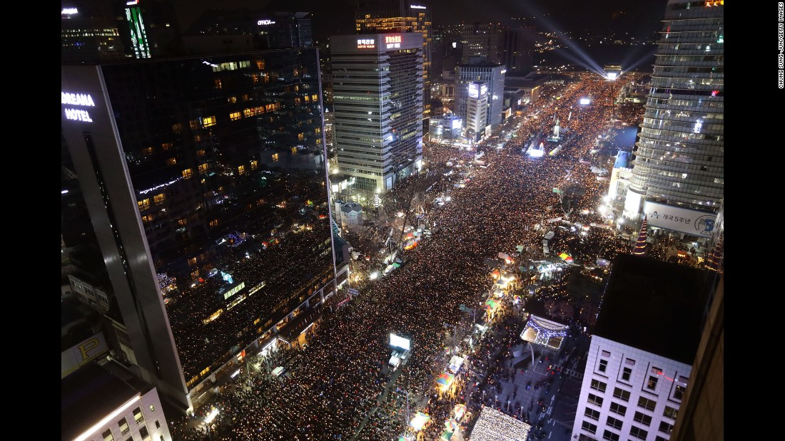 "Protesters gather on the main streets of Seoul, South Korea, for a rally against the country's president, Park Geun-hye, on Saturday, December 3. Park has been dogged by a classified information scandal involving a longtime friend, and therefore faced <a href=""http://www.cnn.com/2016/12/03/asia/south-korea-impeach-park/"" target=""_blank"">an ultimatum from her party</a>: Announce a timeline for her resignation or face possible impeachment. In an overwhelming 234-56 vote on Friday, December 9, lawmakers in South Korea's National Assembly voted to impeach Park."