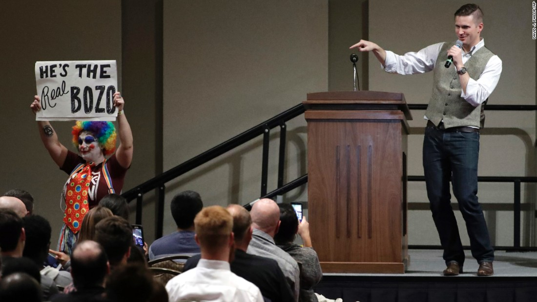 "Richard Spencer, a white nationalist who helped found the so-called alt-right movement, points to a demonstrator carrying a sign as he speaks at Texas A&M University in College Station, Texas, on Tuesday, December 6. Spencer, whose appearance <a href=""http://www.cnn.com/2016/12/06/politics/richard-spencer-texas-am/index.html"" target=""_blank"">drew wide protests</a>, was invited to speak by Texas A&M alum Preston Wiginton, not by the university."