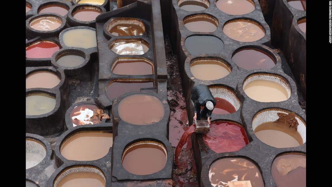 Dried-earth pits are filled with various dyes and liquids at the Chouara Tannery in Fez, Morocco, on Tuesday, December 6. The Chouara Tannery is in the ancient Medina of Fez, a UNESCO Heritage Sight.