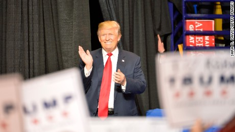 "President-elect Donald Trump claps with the cheers from his supporters as he enters for his ""Thank You"" tour at Crown Coliseum on December 6, 2016 in Fayetteville, North Carolina."