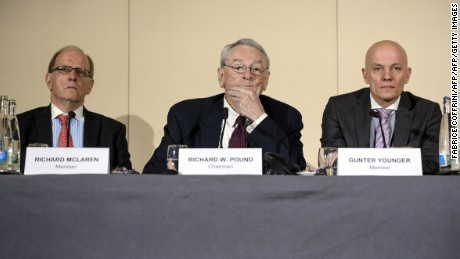 (From L) Barrister & Solicitor Richard McLaren, former World Anti-Doping Agency (WADA) President and chairman of the WADA independent commission Richard W Pound, and Head of Department Cybercrime with Bavarian Landeskriminalamt (LKA) Guenter Younger are pictured during the presentation before the press of a report on corruption and money-laundering within international athletics on November 9, 2015 in Geneva. Just 270 days out from the start of the 2016 Rio Olympics, an independent commission set up by the WADA released its findings into a scandal already viewed as more damaging than the corruption crisis engulfing world football governing body FIFA. WADA wants lifetime bans for 5 Russian athletes, including 800m Olympic champion. AFP PHOTO / FABRICE COFFRINI        (Photo credit should read FABRICE COFFRINI/AFP/Getty Images)