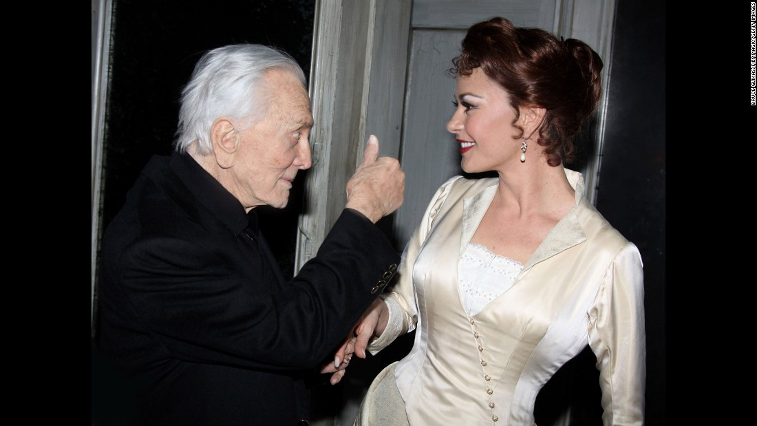 "Douglas greets his daughter-in-law Catherine Zeta-Jones backstage at ""A Little Night Music"" on Broadway in 2009. She was starring in a revival of the Stephen Sondheim-Hugh Wheeler musical."