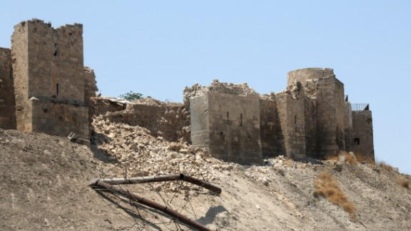 A July 2015 blast leaves the wall of the once monumental Citadel in Aleppo's old city damaged.