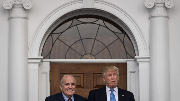 Former New York City mayor Rudy Giuliani stands with president-elect Donald Trump before their meeting at Trump International Golf Club on November 20, 2016, in Bedminster Township, New Jersey.