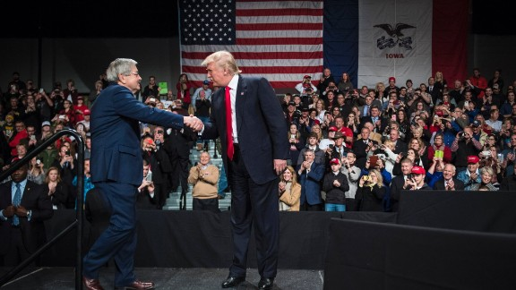 Trump shakes hands with Iowa Gov. Terry Branstad at an event in Des Moines, Iowa, on Thursday, December 8. Trump re-introduced Branstad as his pick for US ambassador to China.