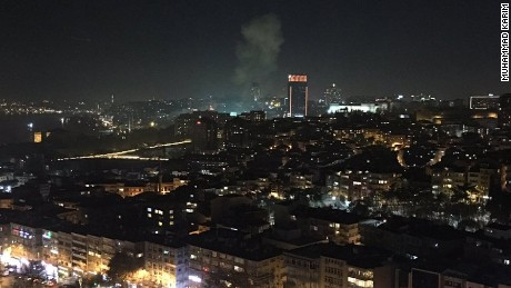 "Muhammad Karim took this image showing the smoke from the explosions and a video showing a number of emergency vehicles responding to the scene in Istanbul. ""Massive Boom in Istanbul. Two of them. In or near Besiktas Stadium,"" he posted on Twitter."
