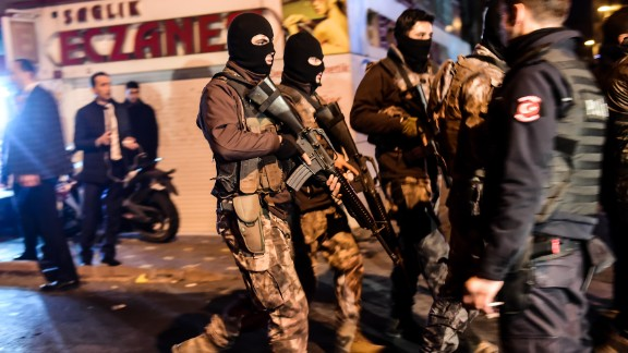 Turkish special police officers patrol streets after a car bomb exploded near the stadium.