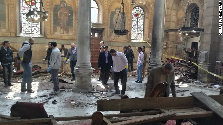 Egyptian security forces examine the scene inside St. Mark Cathedral in central Cairo, following a bombing, Sunday, Dec. 11, 2016.