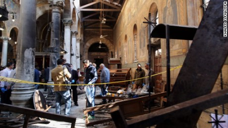 Security officials and people gather at the St. Peter and St. Paul Coptic Orthodox Church after a bombing in Cairo, Egypt on December 11, 2016. Reports state at least 20 people were killed and 35 injured in the explosion outside Cairo's Coptic Cathedral in the Abbassia neighborhood.