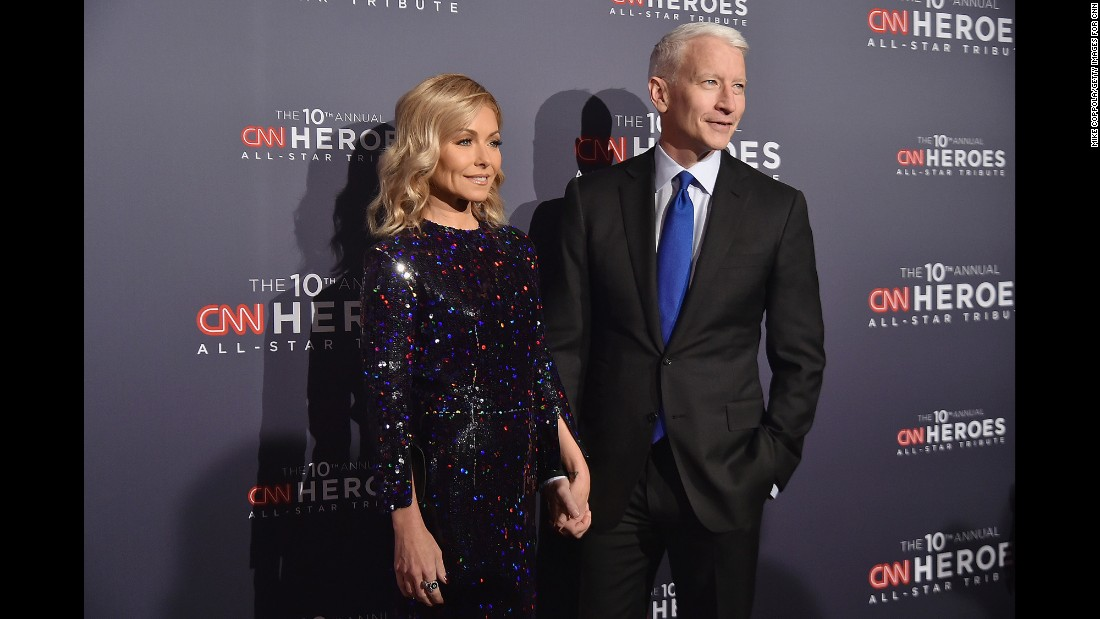 "Hosts Kelly Ripa, left, and Anderson Cooper arrive at the 2016 ""CNN Heroes All-Star Tribute"" at New York's American Museum of Natural History on Sunday, December 11."