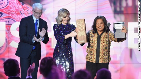 NEW YORK, NY - DECEMBER 11:  Anderson Cooper and Kelly Ripa present an award to CNN Superhero and 2012 CNN Hero of the Year Pushpa Basnet onstage during the CNN Heroes Gala 2016 at the American Museum of Natural History on December 11, 2016 in New York City.