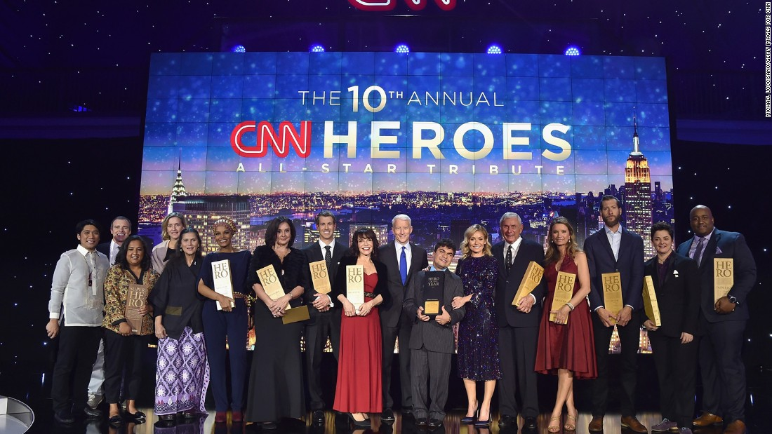 NEW YORK, NY - DECEMBER 11: (L-R) Efren Penaflorida, Brad Ludden, Pushpa Basnet, Liz McCarthey, Umra Omar, Georhie Smith, Chad Pregracke, Sherri Franklin, Anderson Cooper, Jeison Aristizabal, Kelly Ripa, Harry Swimmer, Becca Stevens, Craig Dodson, Luma Mufleh, and Sheldon Smith pose onstage during the CNN Heroes Gala 2016 at the American Museum of Natural History on December 11, 2016 in New York City.26362_013  (Photo by Michael Loccisano/Getty Images for Turner)