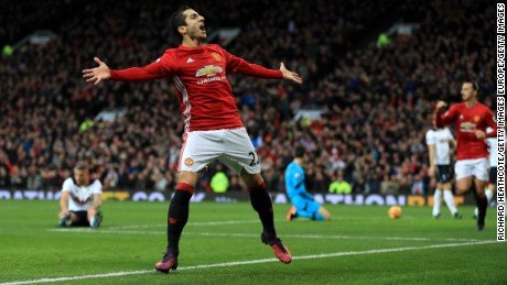 Henrikh Mkhitaryan celebrates scoring the winning goal for Manchester United against Tottenham.
