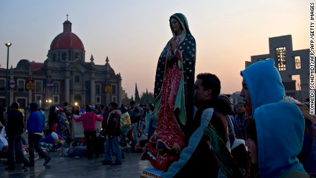 A pilgrim carries an effigy of Our Lady of Guadalupe, Mexico's patron saint, during annual celebrations at the Basilica of Guadalupe in Mexico City, on December 12, 2011.  Mexicans commemorate the apparition of Our Lady of Guadalupe to Juan Diego in 1531.   AFP PHOTO/Ronaldo SCHEMIDT (Photo credit should read Ronaldo Schemidt/AFP/Getty Images)